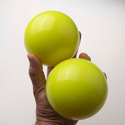 griping oversized juggling balls